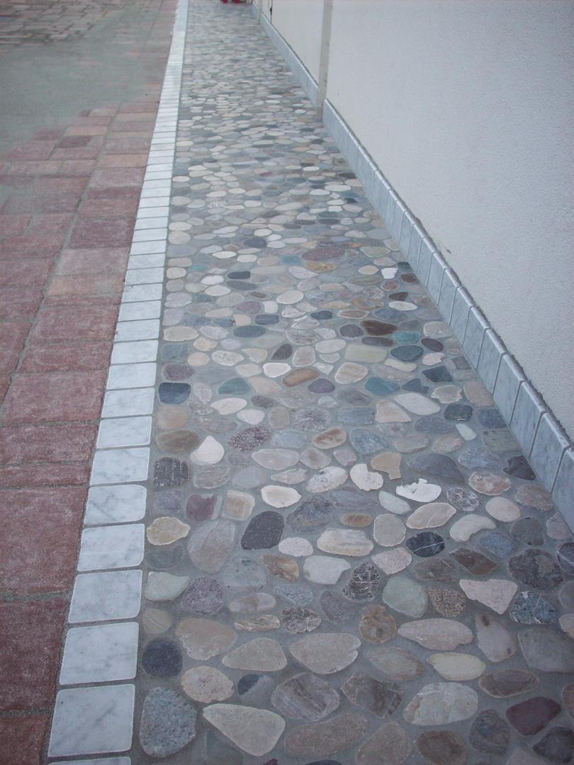 Pavimenti in sassi del piave